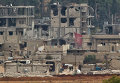 Предположительно курдские боевики в разрушенном городе Кобани, Сирия. Вид с холма на границе Турции и Сирии. 17 ноября 2014